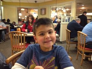 Micah patiently waiting for his 'Funny Face' pancake.
