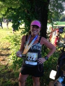 Shari at the finish line showing off the bling