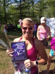 My wife with one of her awards (2nd place age group - Mother's Day 10K)