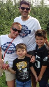 Wearing our race shirts to go apple picking with our boys